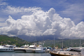 golfe saint-florent saint florent saintflorent corsica cumulus clouds forming mountains taken town st florent. sky natural history nature weather meteorology formation rain shower storm precipitation updraft thermals cumulo-nimbus cumulo nimbus cumulonimbus thunderstorm lightning hdr corse france la francia frankreich french