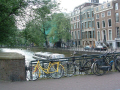 modes travel amsterdam caught together bicycles canal boatnext tree boats marine transport boat bicycle holland la hollande holanda olanda netherlands dutch