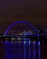 glasgow. river clyde night featuring squinty bridge bathed blue lights reflecting clydeside nationalities nations glasgow scotland central scottish scotch scots escocia schottland united kingdom british