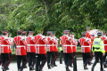 loyal orange lodge parade. band photo red tunics black trousers. tree lined entering park march procession gathering glasgow central scotland scottish scotch scots escocia schottland united kingdom british