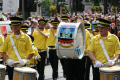 loyal orange lodge parade. band march wearing yellow shirts dark trousers. bass drummer drummers procession gathering glasgow central scotland scottish scotch scots escocia schottland united kingdom british