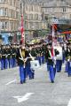 loyal orange lodge parade. flag bearers leading parade band. glasgow tenements visible. gathering procession central scotland scottish scotch scots escocia schottland united kingdom british