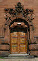 gable end doorway kelvingrove art gallery museum sculpture above. uk museums british architecture architectural buildings red sandstone glasgow central scotland scottish scotch scots escocia schottland united kingdom