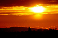 silhouette buildings flying aeroplane evening sunset. milngavie scotland sunsets dusk aircraft red orange sky glasgow central scottish scotch scots escocia schottland united kingdom british