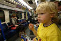 young boy inside london tube carriage underground metro buildings architecture capital england english cockney angleterre inghilterra inglaterra united kingdom british