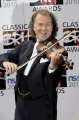 andre rieu dutch violinist conductor composer famous creating waltz-playing waltz playing waltzplaying johann strauss orchestra classical musicians celebrities celebrity fame star white caucasian portraits