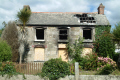 damaged burnt-out burnt out burntout house brigade firemen uk emergency services united kingdom british