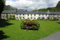flower display cottages beddgelert uk british housing houses homes dwellings abode architecture architectural buildings snowdonia gwynedd wales welsh pa gales united kingdom