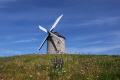 windmill white sails situated hill blue skies flowers etretat region normandy france french buildings european haut normandie sunshine isolated summer travel holiday tourism europe haute la francia frankreich