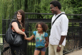 mixed race family standing together outside sun multicultural ethnic minority summer unity mother father black white daughter love togetherness