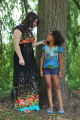 white mother mixed race daughter standing together tree smiling multicultural ethnic minority summer unity love togetherness