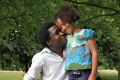 mixed race girl park leaning black father multicultural ethnic minority summer unity love togetherness daughter happiness happy