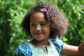 head shoulders shot young mixed race girl smiling multicultural ethnic minority portrait face summer smile happiness happy