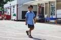 young asian boy walking primary school playground multicultural ethnic minority summer child children education learning junior asians play