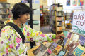 asian woman looking book bookshelf library multicultural ethnic minority asians choice search books libraries