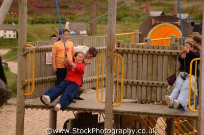 children rope swing adventure playground infant groups people persons play cornwall cornish england english angleterre inghilterra inglaterra united kingdom british