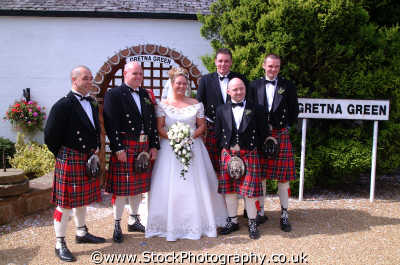 gretna green wedding group costumes costumed people persons weddings matrimony marriage scots kilts bride groom dumfries galloway dumfrieshire dumfriesshire scotland scottish scotch escocia schottland united kingdom british