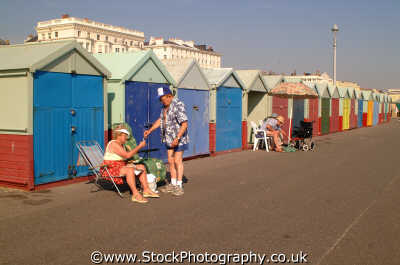 brighton relaxing outside beach huts british beaches coastal coastline shoreline uk environmental seaside sussex home counties england english angleterre inghilterra inglaterra united kingdom