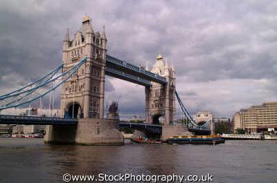 tower bridge tugboat towing container barge thames bridges crossing london capital england english uk city cockney angleterre inghilterra inglaterra united kingdom british