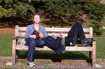couple twenties bench thames london capital england english uk tenderness togetherness contentment caress surrey angleterre inghilterra inglaterra united kingdom british