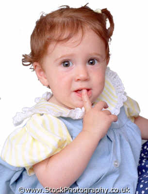 baby girl ginger hair thoughtful finger mouth babies infants girls female children kids juveniles females feminine womanlike womanly womanish effeminate ladylike people persons quiet consider ponder contemplate deliberate reflect white caucasian portraits