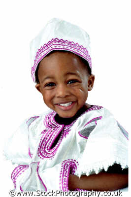boy little traditional african costume boys male child males masculine manlike manly manful virile mannish people persons smiles negroes black ethnic portraits