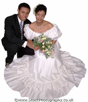 couple bride sitting bouquet groom keeling middle aged couples midlife husband wife boyfriend girlfriend spouse families family kin kinfolk tribe generations geneaology people persons marriage matrimony wedlock negroes black ethnic portraits