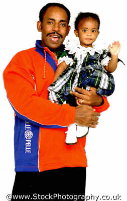 dad man orange holding daughter fathers daughters dads pops offspring parents children generations parentage parenting families family kin kinfolk tribe geneaology people persons negroes black ethnic portraits