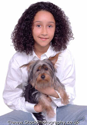 girl early teens holding pet dog teenage girls teenagers adolescent female children kids juveniles infants females feminine womanlike womanly womanish effeminate ladylike people persons best friends cute faithful mixed race ethnic portraits