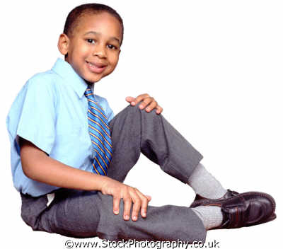 boy school uniform sitting boys male child males masculine manlike manly manful virile mannish people persons smart schoolboy intelligent clever brainy negroes black ethnic portraits
