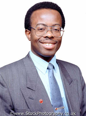 businessman thirties glasses moustache smiling businessmen male business fairness honesty decency integrity impartial virtue morality negroes black ethnic portraits