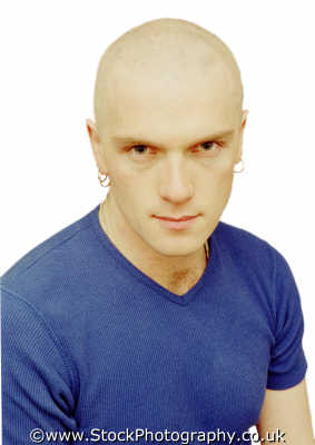 man. twenties bald earings young men adult males masculine manlike manly manful virile mannish people persons scowl gay hairy chest intense white caucasian portraits