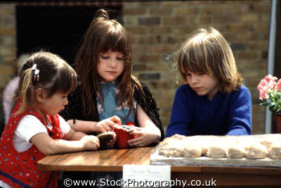 girls playing table female children kids juveniles infants females feminine womanlike womanly womanish effeminate ladylike people persons playtime white caucasian portraits