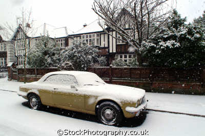 snow covered daimler car outside subrurban homes motor cars automobiles transport transportation uk winter weather richmond london cockney england english angleterre inghilterra inglaterra united kingdom british