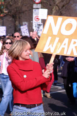 woman waving war banner peace march young women female females feminine womanlike womanly womanish effeminate ladylike people persons anti american usa globalisation civil disobedience direct action rally demonstrations white caucasian portraits united kingdom british