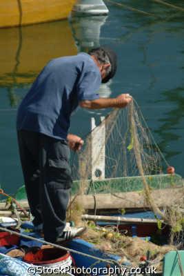 portugese fisherman repairing nets algarve portuguese european travel working man portugal europe