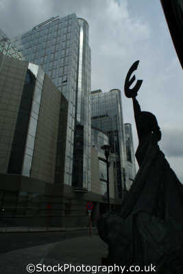 european union parliament building statue woman holding euro symbol brussels belgian travel government politics political power eu bruxelles belgium belgië belgique belgien europe
