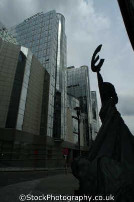 european union parliament building statue woman holding euro symbol brussels belgian travel government politics political power eu bruxelles belgium belgië belgique belgien europe