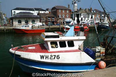 fishing boat moored weymouth harbour harbor uk coastline coastal environmental dorset england english angleterre inghilterra inglaterra united kingdom british