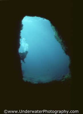 diver looking cave mouth caves caverns seascapes scenery scenic underwater marine diving peek explore benny sutton cyprus europe european cypriot