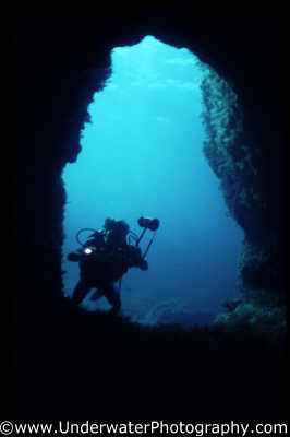 diver looking cave torch caves caverns seascapes scenery scenic underwater marine diving benny sutton cyprus europe european cypriot