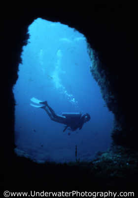 diver mid water cave mouth caves caverns seascapes scenery scenic underwater marine diving cavern benny sutton cyprus europe european cypriot