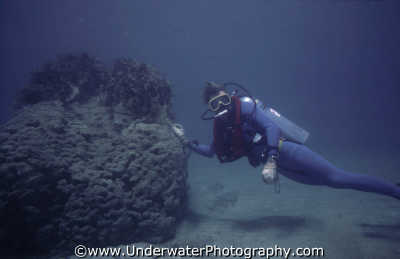 diver leaning rock divers diving people scuba underwater marine weightless buoyancy benny sutton cyprus europe european cypriot