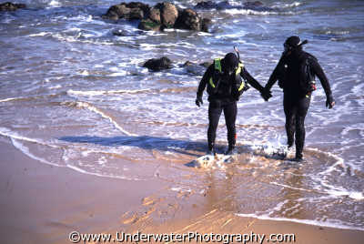 divers making shore entry surf entering water diving people scuba underwater marine monterey california californian usa united states america american