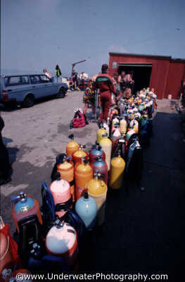 diving cylinders waiting filled equipment kit divers people scuba underwater marine air dive store england english angleterre inghilterra inglaterra united kingdom british