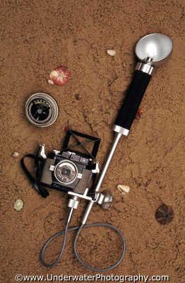 calypsophot camera bulb flash sekonic handheld meter cameras photography photographic underwater photographers divers diving people scuba marine equipment honduras honduran