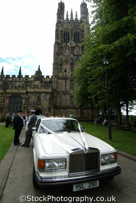 wedding cars outside st gile church wrexham uk churches worship religion christian british architecture architectural buildings wales welsh país gales united kingdom