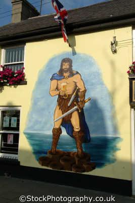 giant warrior mural bushmills uk coastline coastal environmental basalt columns hexagonal giants causeway county antrim aontroim northern ireland ulster irish irland irlanda united kingdom british