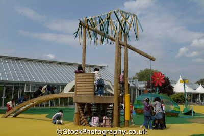 multi ethnic group children play infant groups people persons playground swing richmond london cockney england english angleterre inghilterra inglaterra united kingdom british