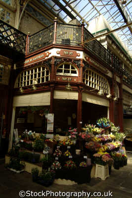 halifax borough market hall florist stall uk markets traders commercial buildings retailers british architecture architectural flower seller yorkshire england english angleterre inghilterra inglaterra united kingdom